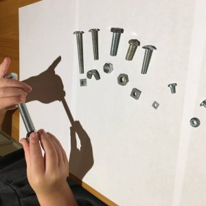 Child playing with nuts and bolts