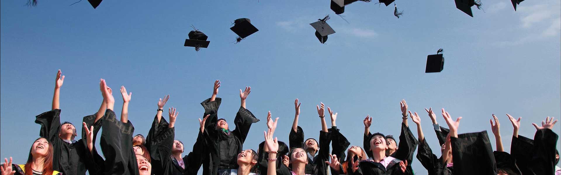 Graduates throwing hats