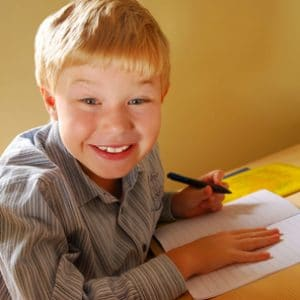 Boy Writing at Desk