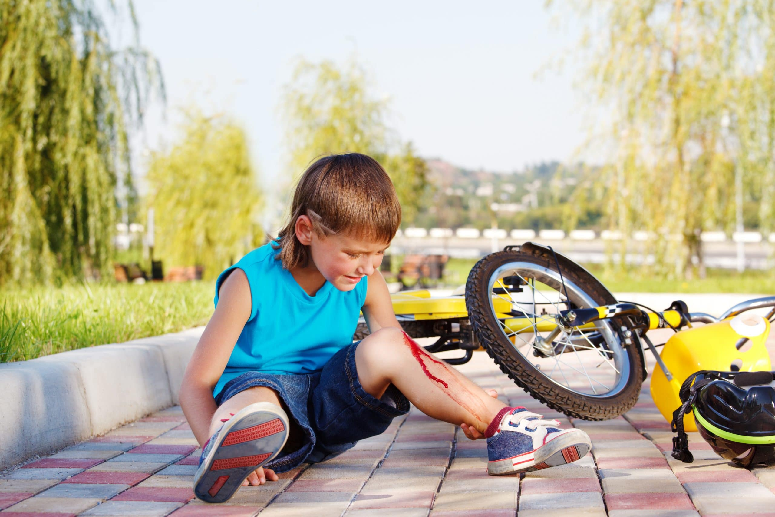 Boy crying after falling off bike